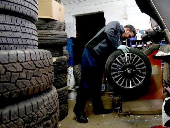 Veli Talybov of Oak Park, a tire technician, works