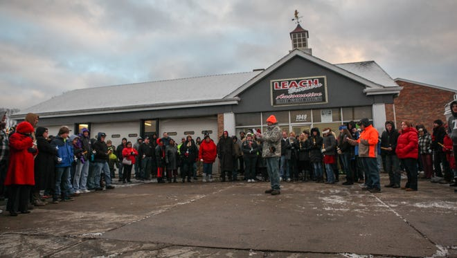 Over 100 people gathered outside of Leach Brothers Automotive Sunday evening to mourn the death of Joe Leach, who was shot in the back during an armed robbery on Jan. 5. Leach died Friday, three days after the shooting.
