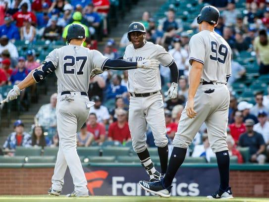 New York Yankees shortstop Didi Gregorius (18) is greeted
