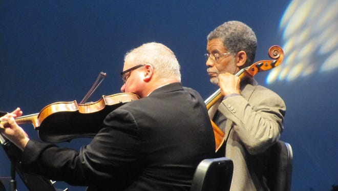 Listeners will surround players onstage at Music Hall in the new CSO Chamber Players season. Performing here are violinist Paul Frankenfeld and cellist Norman Johns.