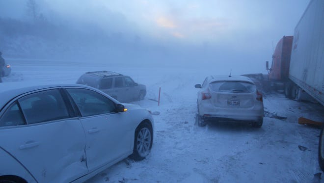 Mangled vehicles clog U.S. Highway 218 northbound near Waverly during a Jan. 26 whiteout. The 16-car chain-reaction pileup injured 11 people.