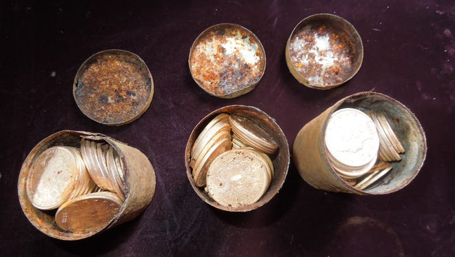Cans filled with 19th Century gold cions are viewed in this undated handout photo courtesy of Kagin's, Inc. on February 26, 2014. A California couple out walking their dog struck it rich by unearthing a horde of buried gold coins, worth more than $10 million according to experts. The so-called Saddle Ridge find is believed to be the most valuable treasure trove ever discovered in the United States, according to Kagin's Inc, which specializes in ancient gold coins.
