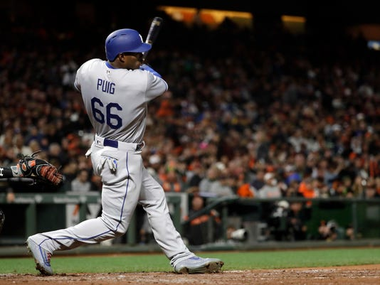 Los Angeles Dodgers' Yasiel Puig (66) singles during the fifth inning of a baseball game against the San Francisco Giants, Monday, April 24, 2017, in San Francisco . (AP Photo/Marcio Jose Sanchez)