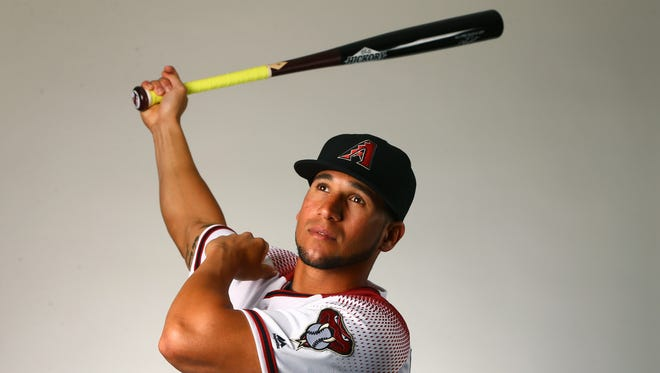 David Peralta was released as a pitcher by the St. Louis Cardinals. He and his father rebuilt him into a major league hitter.