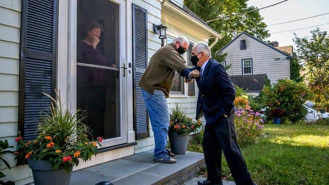 Sen. Jack Reed campaigns door to door in the Edgewood section of Cranston.