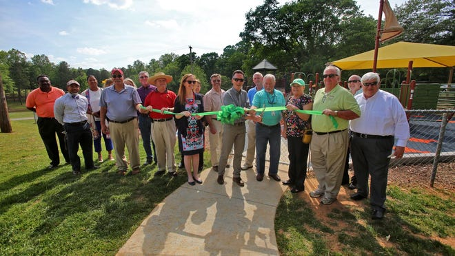 A ribbon officially opened the new all-inclusive playground at Holly Oak Park in Shelby.