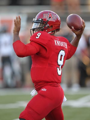 Arkansas State quarterback Fredi Knighten threw for two touchdowns after missing three games with an injury.