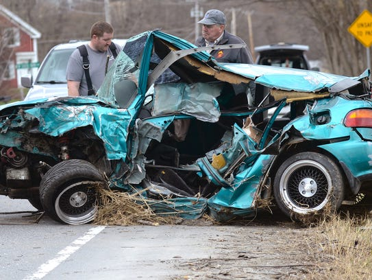 Crews work to remove a car from Vermont 116 in Hinesburg