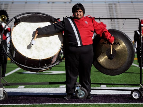 Colorado High School senior Jordan Lopez plays the bass drum and gong during the Pride of Wolf Country band's performance at the UIL Region 6 East Zone Marching Contest Monday Oct. 23, 2017. Fifteen schools competed at Wylie High School's Bulldog Stadium.