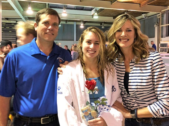 Senior Swim - Memorial High School swimmer Amy Goris celebrated Senior Night with her parents Jim and Lori Goris. The Tigers have 12 seniors on the Swim and Dive team that were honored during their last home meet. Amy will be entering the Kelley School of Business at Indiana University this fall.