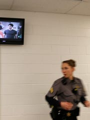 Sgt. Cook, a records supervisor at the San Juan County Adult Detention Center, walks through the center's medical facility on Friday in Farmington.  Employees did not provide their full names because of security concerns.