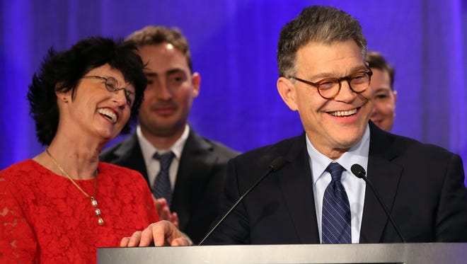 Sen. Al Franken, D-Minn., accompanied by his wife Franni and other relatives, addresses Democratic party night supporters after winning his Senate race against Republican Mike McFadden.