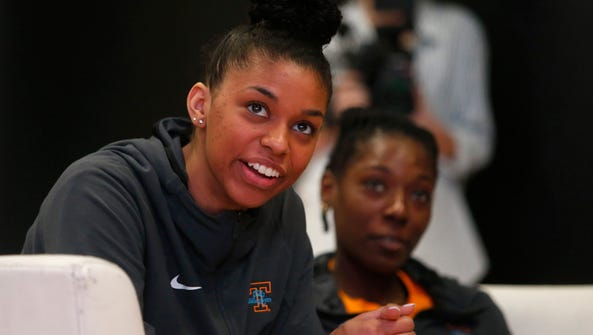 Evina Westbrook, left, and teammate Rennia Davis, right,