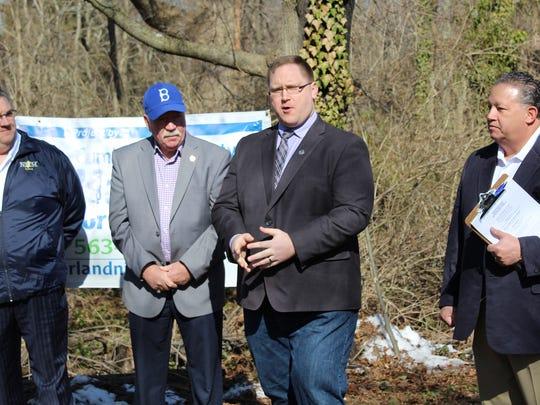 Assemblyman Bob Andrzejczak (center left), gives a