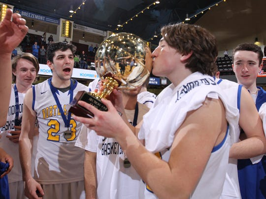 North Salem's John Martabano (20) kisses the gold ball after defeating Hamilton 61-57 in the Section 1 Class C boys final basketball game at the Westchester County Center in White Plains on Saturday, March 4, 2017.