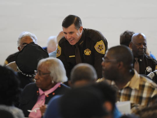 Northampton County Sheriff David Doughty greets attendees during the 26th annual Community Unity Day Breakfast held at Northampton High School in Eastville, Va. on Monday, Jan. 18, 2016.