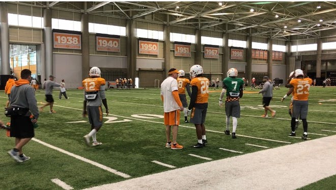 Tennessee coach Butch Jones instructs freshman defensive back Baylen Buchanan during practice on Friday afternoon.