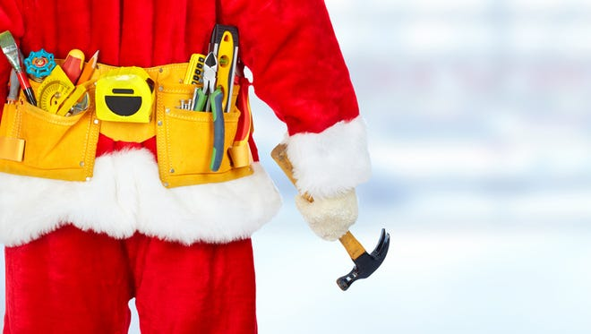 Santa construction worker with tool belt. Christmas renovation concept