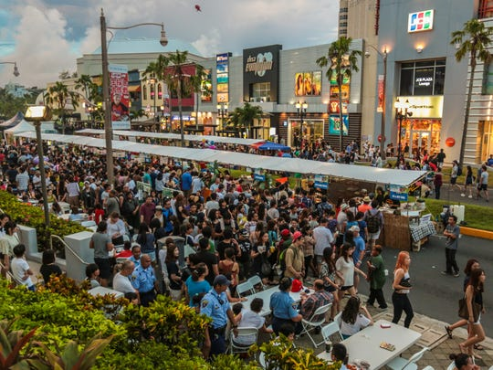 Crowds line up to purcahse food from vendors during the 3rd Annual Guam BBQ Block Party held at Tumon on July 18, 2015.