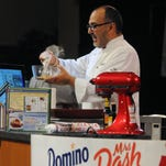 Chef Eric Villegas, of the Taste of Home Cooking School, demonstrates a recipe onstage. The culinary event comes to Great Falls on Tuesday, May 10.
