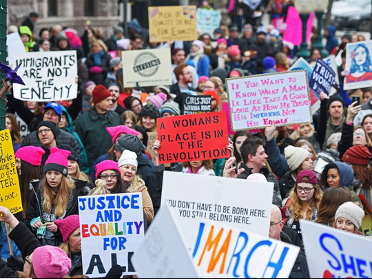Demonstrators take part in the Women's March Sioux