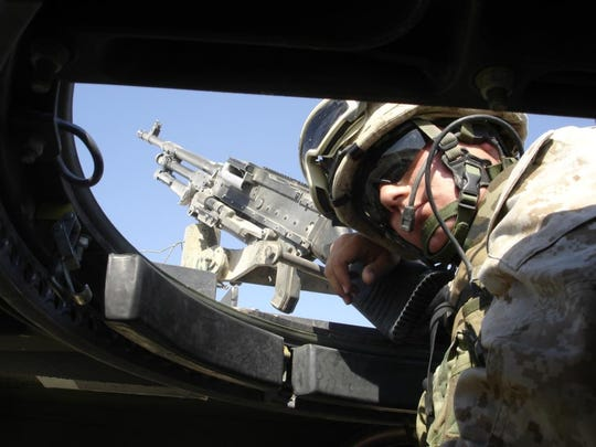 Cpl. Chad Oligschlaeger mans a machine gun in a military vehicle. In May 2008, Oligschlaeger died of multiple drug toxicity, brought on by a mix of seven drugs, six of which were prescribed by the military for his post-traumatic stress disorder.