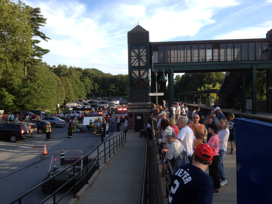 Passengers wait for shuttle buses after a rock slide took out tracks between Garrison and Peekskill July 19, 2014.