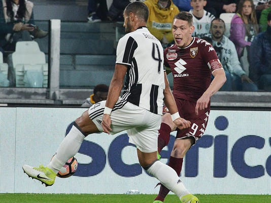Juventus' Medhi Benatia, left, and Torino's Andrea Belotti vie for the ball during the Italian Serie A soccer match between Juventus and Torino at the Juventus Stadium in Turin, Italy, Saturday, May 6, 2017. (Alessandro Di Marco/ANSA via AP)