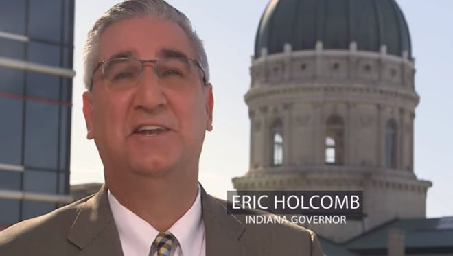 Screenshot of Indiana Gov. Eric Holcomb's appearance in an advertisement for Illinois Gov. Bruce Rauner.