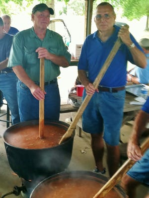 Browns Church Ruritan stew masters Lee Tomlinson and David Pearson will be cooking 100 gallons or more of stew at the Browns United Methodist Church pavilion on Labor Day weekend.