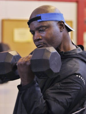 Aundray Bruce, former Auburn and NFL football player, lifts some weights while at the Southeast YMCA on Monday, April 22, 2013, in Montgomery, Ala. Now 51 years old, Bruce says he's still working out and doesn't have any life-threatening injuries.