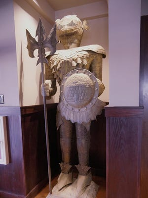 An old knight's suit of armor is a relic of the old Roman Forum that once occupied the same building as Black Rock.