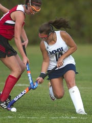 Mount Mansfield's Margaret Thompson takes the ball from CVU's Emily Ray during a high school field hockey game last season.