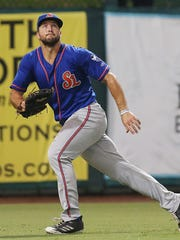 St. Lucie Mets outfielder Tim Tebow fields a fly ball