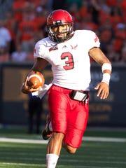 Eastern Washington quarterback Vernon Adams (3) heads upfield against Oregon State on Aug. 31, 2013.