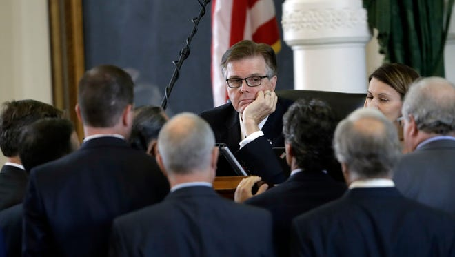 Texas Lt. Gov. Dan Patrick, center, listens to fellow lawmakers during a point of order discussion July 18 in the Senate chamber in Austin.  He said allowing filmmakers to use the chamber to film a movie about former state Sen. Wendy Davis would be a disgrace.