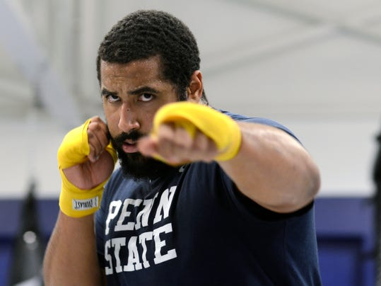 In this Tuesday, March 18, 2014 photo, Penn State lineman John Urschel warms up before a mixed martial arts workout in State College, Pa.  If it wasn't for my MMA workouts in the afternoons, I don't know how I would get all my aggression out. Football has many virtues, but for myself, I would say this is the greatest. It is a platform for me to get out all aggressive and physical behavior that is not socially acceptable outside of the gridiron. (AP Photo/Ralph Wilson)