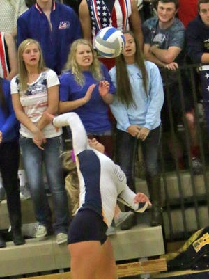 Elizabeth Storm goes up for a kill during Friday's match. She had six on the night and was a key on defense, with 15 digs, as Hartland fell to Milford in five games in a Class A district championship match.