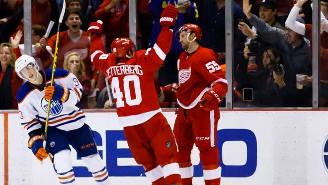 Red Wings defenseman Niklas Kronwall (55) receives congratulations from left wing Henrik Zetterberg (40) after scoring an overtime goal against the Oilers at Joe Louis Arena Friday.