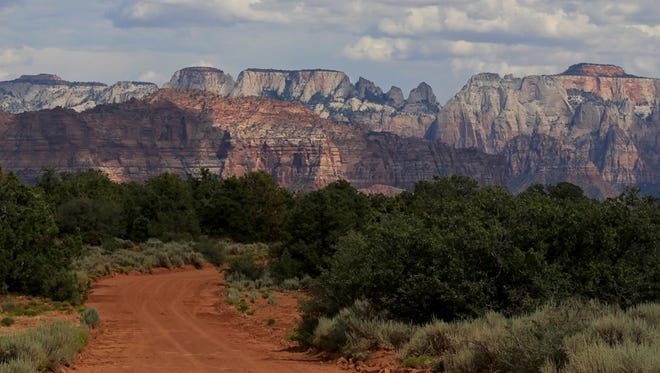 Clouds hover over Zion National park in this image of Zion National Park as seen from Virgin, Utah.
