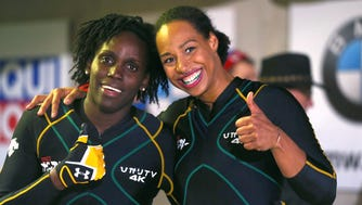 Jazmine Fenlator-Victorian and Carrie Russell of Jamaica during the BMW women`s bobsled World Cup.
