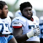 Titans guard Chance Warmack, right, talks with tackle Jeremiah Poutasi during practice in August.