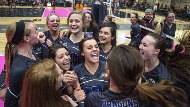 Johnston players celebrate their win over Ankeny Tuesday at the state volleyball tournament.