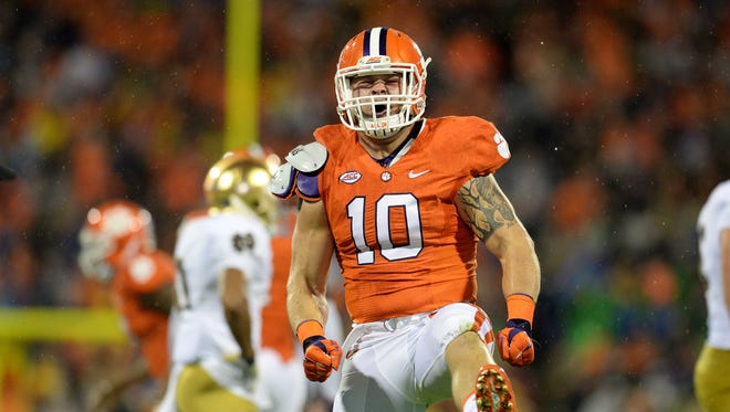 Clemson linebacker Ben Boulware (10) celebrates after the Tiger's defense stopped Notre Dame running back C.J. Prosise (20) for a loss during the 1st quarter Saturday, October 3, 2015 at Clemson's Memorial Stadium.
