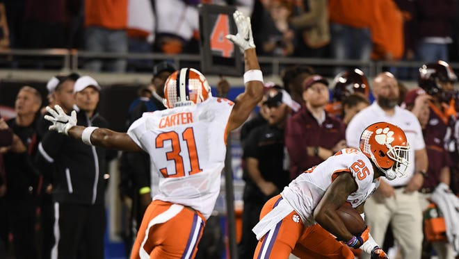 Clemson defensive back Cordrea Tankersley (25) intercepts a Virginia Tech pass during the 4th quarter of the ACC Championship at Camping World Stadium in Orlando on Saturday, December 3, 2016.