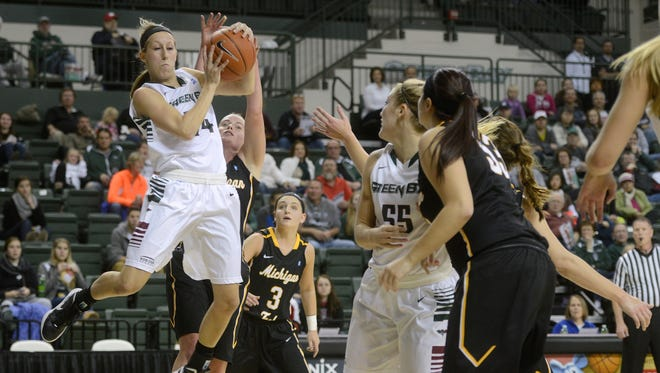 Green Bay Phoenix guard Allie LeClaire brings down a rebound in the first half against Michigan Tech.