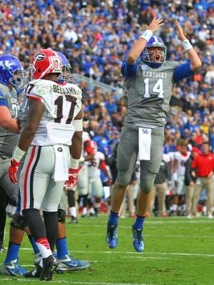 Patrick Towles celebrates a touchdown late in the first half of UK's game Saturday against Georgia. The Cats trailed 35-24 at the break.
