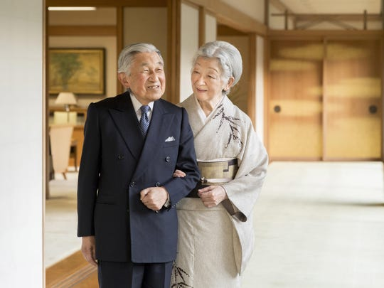 Japan's Emperor Akihito, left, and Empress Michiko, right, pose for a photograph at the Imperial Palace in Tokyo. Emperor Akihito, who turns 85 on Sunday, Dec. 23, and will abdicate this spring, says he feels relieved to see the era of his reign coming to an end without having seen his country at war.