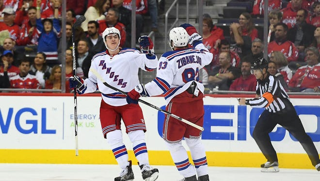 Jimmy Vesey (26) celebrates one of his two goals with Mika Zibanejad (93) Saturday.