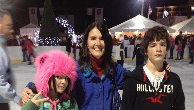 Here's the Oeth family during the first year of Christmas on Ice. The Dear Daughter was a pink blur she was skating so fast that night.